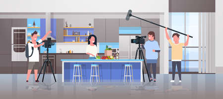 operators using video camera recording food blogger woman preparing tasty dishes videographers using professional equipment cooking blog film production concept kitchen interior horizontal vector illustration