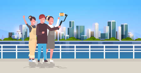 casual people using 3-axis gimbal stabilizer selfie stick for smartphone happy tourists taking photo standing together over cityscape background horizontal full length vector illustration