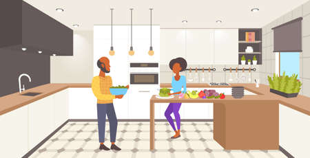 african american couple cooking together woman slicing vegetables at home modern kitchen interior man woman preparing food full length flat horizontal vector illustration