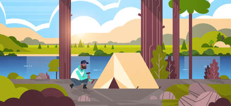 african american man hiker camper installing a tent preparing for camping hiking concept sunrise landscape nature river mountains background flat horizontal full length vector illustration