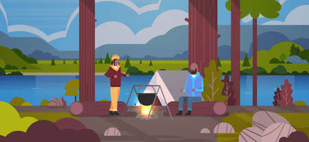 african american couple hikers man woman cooking meals in bowler boiling pot at campfire near camp tent camping concept landscape nature river mountains background horizontal full length vector illustration