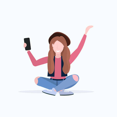woman taking selfie photo on smartphone camera casual female cartoon character sitting girl in hat posing on white background flat full length vector illustration Illusztráció
