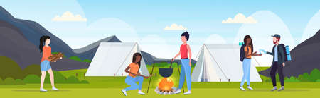 hikers group having fun preparing food in bowler boiling pot at campfire hiking concept mix race travelers on hike tent camping campsite landscape background full length flat horizontal vector illustration
