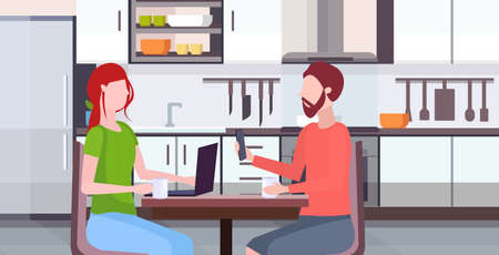 couple sitting at table woman using laptop man holding smartphone digital gadget addiction concept modern kitchen interior flat portrait horizontal vector illustration Vettoriali