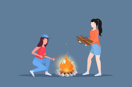 women hikers making fire couple girls holding firewood for bonfire hiking camping concept travelers on hike horizontal full length flat vector illustration