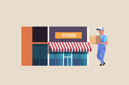postman in uniform carrying cardboard parcel box courier express delivery service concept modern store building exterior flat full length horizontal vector illustration
