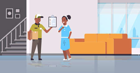 postman in uniform holding cardboard parcel box african american courier showing clipboard to woman recipient express delivery service concept modern living room interior flat full length vector illustration