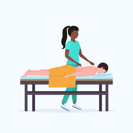 african american acupuncturist holding needle man patient getting acupuncture treatment guy relaxing lying on bed treatments alternative medicine concept full length vector illustration Stock Illustratie