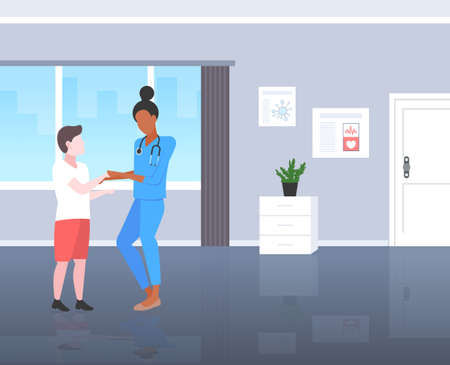 doctor pediatrician reassuring boy patient woman in uniform examining male kid medical consultation healthcare concept modern pediatric department hospital room interior full length flat vector illustration  イラスト・ベクター素材