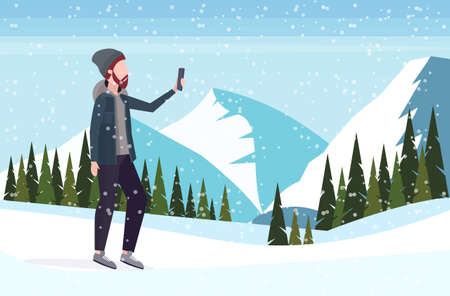 man taking selfie photo on smartphone camera casual male cartoon character posing snowy mountains landscape background flat full length vector illustration