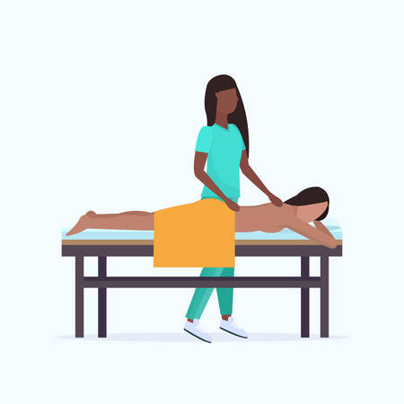 young girl having back massage african american masseuse therapist in uniform massaging patient body woman relaxing lying on bed spa salon treatments concept full length vector illustration