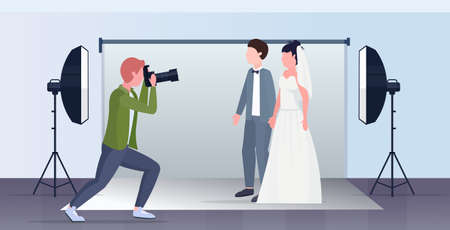 professional wedding photographer shooting on camera newly weds couple bride and groom embracing posing in modern photo studio interior full length flat horizontal vector illustration
