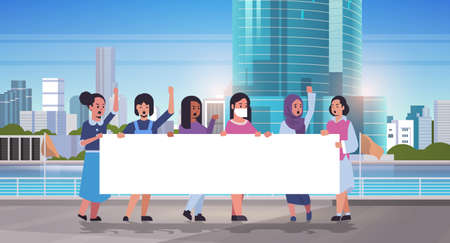 women protesters holding blank placard mix race girls activists with empty sign banner protest demonstration strike concept modern cityscape skyline background flat full length horizontal vector illustration Ilustrace