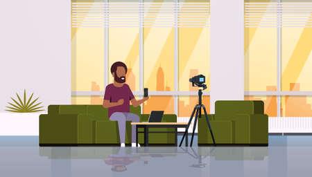 guy technology blogger recording video on camera man showing new smartphone functional testing blog concept modern apartment interior full length horizontal vector illustration