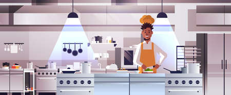 male professional chef cook chopping vegetables on carving board african american man in uniform preparing salad cooking food concept modern restaurant kitchen interior portrait horizontal vector illustration