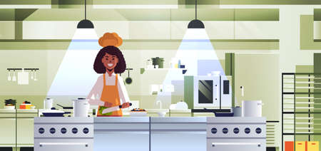 female professional chef cook chopping vegetables on carving board african american woman in uniform preparing salad cooking food concept modern restaurant kitchen interior portrait horizontal vector illustration Foto de archivo - 133655455