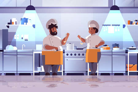 professional chefs couple preparing and tasting dishes african american woman man in uniform standing together near stove cooking food concept modern kitchen interior flat full length horizontal vector illustration