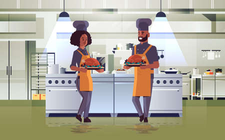 professional chefs couple holding trays with roasted chicken man woman in uniform carrying thanksgiving turkey cooking food concept modern restaurant kitchen interior full length horizontal vector illustration
