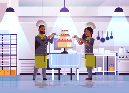 professional pastry chefs couple decorating tasty wedding cream cake african american woman man in uniform cooking food concept flat modern restaurant interior full length horizontal vector illustration