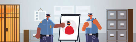 mix race policemen officers couple looking at board with thief photo security authority justice law service concept modern police department interior flat portrait horizontal vector illustration