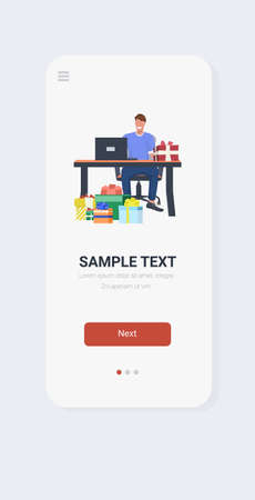 businessman sitting at workplace with gift boxes business man office worker using laptop christmas holiday celebration concept smartphone screen online mobile app vertical full length vector illustration Ilustracja