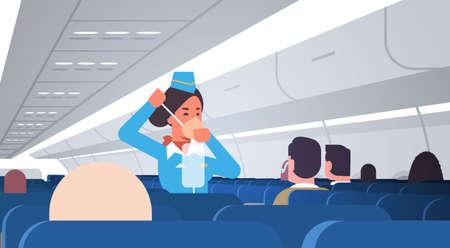 azafata explicando a los pasajeros cómo usar la máscara de oxígeno en una situación de emergencia concepto de demostración de seguridad del asistente de vuelo ilustración de vector horizontal interior de tablero de avión moderno Ilustración de vector