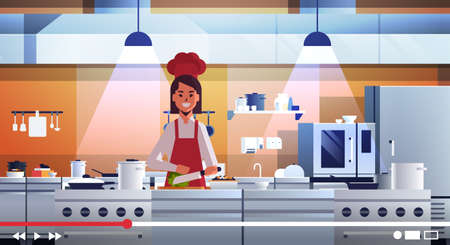 food blogger recording online video female chef in uniform cooking in kitchen blogging concept woman vlogger explaining how to cook a dish portrait horizontal vector illustration