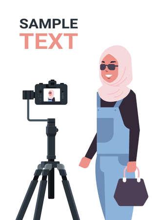 arabic woman blogger recording video blog with digital camera on tripod live streaming social media blogging concept portrait vertical copy space vector illustration