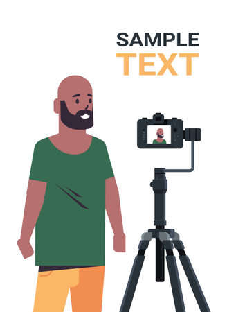 african american man blogger recording video blog with digital camera on tripod live streaming social media blogging concept portrait vertical copy space vector illustration