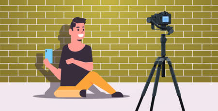 technology blogger testing smartphone man explaining digital gadget functional recording video blog with camera on tripod live streaming social media blogging concept full length horizontal vector illustration