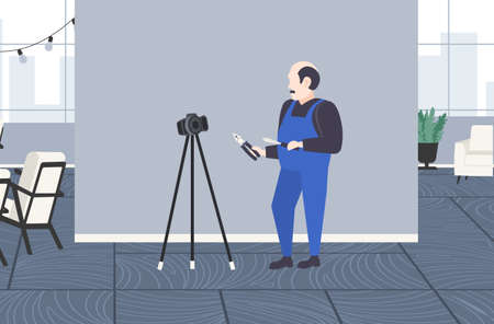handyman worker with screwdriver and cutting pliers blogger recording online video with digital camera on tripod social network blogging concept modern apartment interior full length horizontal vector illustration