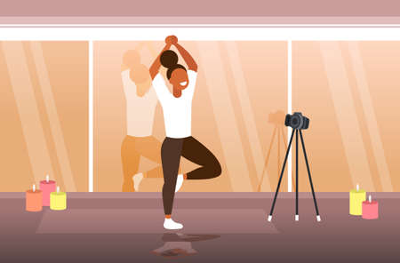woman blogger doing yoga exercises sportswoman recording online video with camera on tripod healthy lifestyle live streaming blogging concept modern gym interior horizontal full length vector illustration