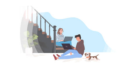 man woman using laptops couple sitting on staircase spending time together modern hallway interior