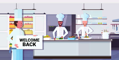 chef cook holding welcome back sign board coronavirus quarantine is ending victory over covid-19 concept