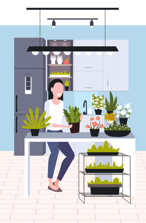 young woman taking care of houseplants girl enjoying her ecology hobby stay home lifestyle concept