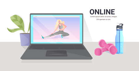 woman doing yoga fitness exercises on laptop screen online training healthy lifestyle concept