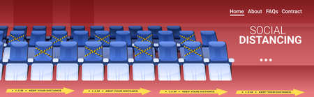 rows of blue seats in empty theater auditorium with protection measures yellow stickers social distancing