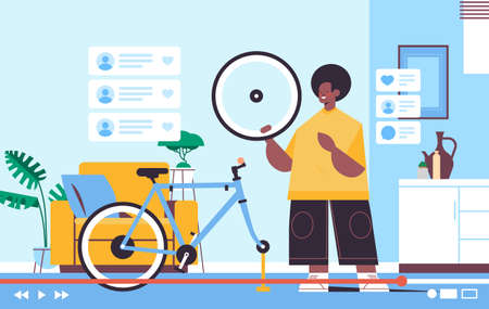 male blogger repairing bicycle recording online video blog live streaming blogging concept