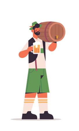 guy waiter holding beer barrel and mug Oktoberfest party concept man in german traditional clothes having fun