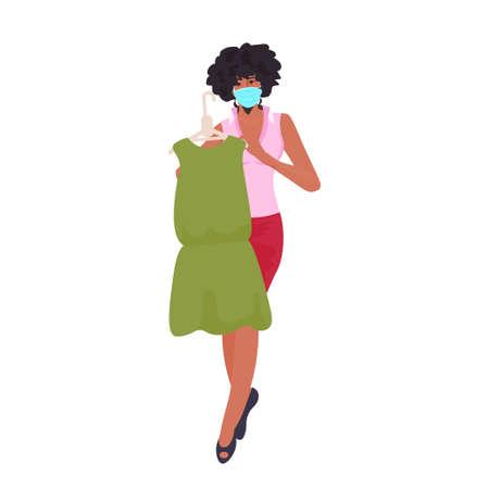 african american saleswoman in mask showing clothes coronavirus pandemic quarantine concept Ilustração