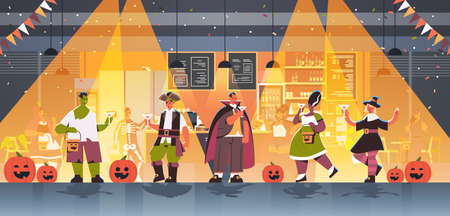 people in different costumes celebrating happy halloween holiday mix race men women drinking cocktails