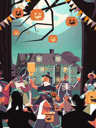 mix race people in costumes walking in town trick or treat happy halloween celebration coronavirus quarantine concept