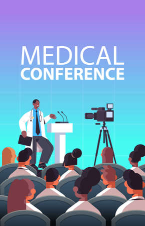 male doctor giving speech at tribune with microphone medical conference medicine healthcare