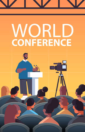 african american businessman giving speech at tribune with microphone on corporate international world conference