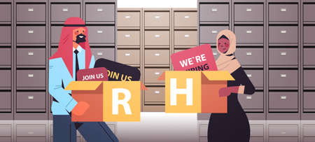 arabic HR managers couple holding cardboard boxes human resources recruitment concept