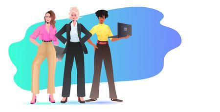 mix race businesswomen in formal wear standing together successful business women using digital gadgets