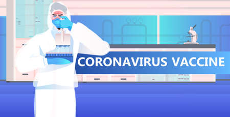 doctor scientist holding test tubes with coronavirus vaccine fight against covid-19 concept medical laboratory interior