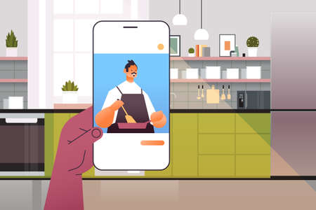 human watching chef food blogger preparing dish on smartphone screen online cooking concept