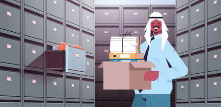 arab businessman holding cardboard box with documents in filing wall cabinet with open drawer data archive storage Vecteurs
