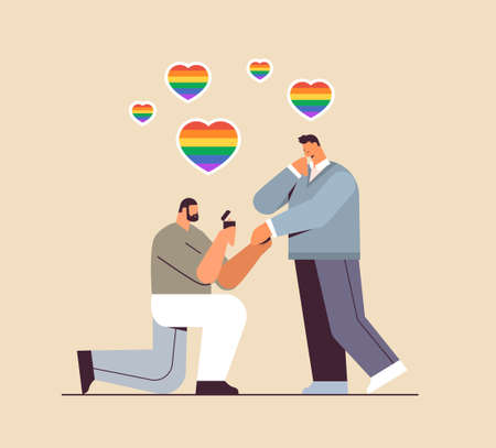 proposing to man down on knee with engagement ring love LGBT community concept